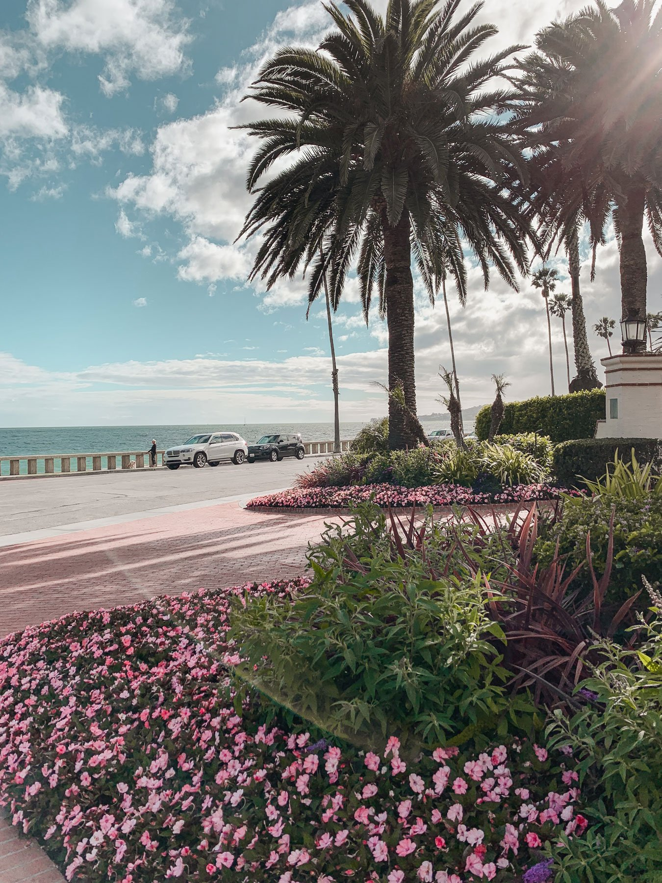 Four Seasons Santa Barbara Entrance with flowers and plam trees