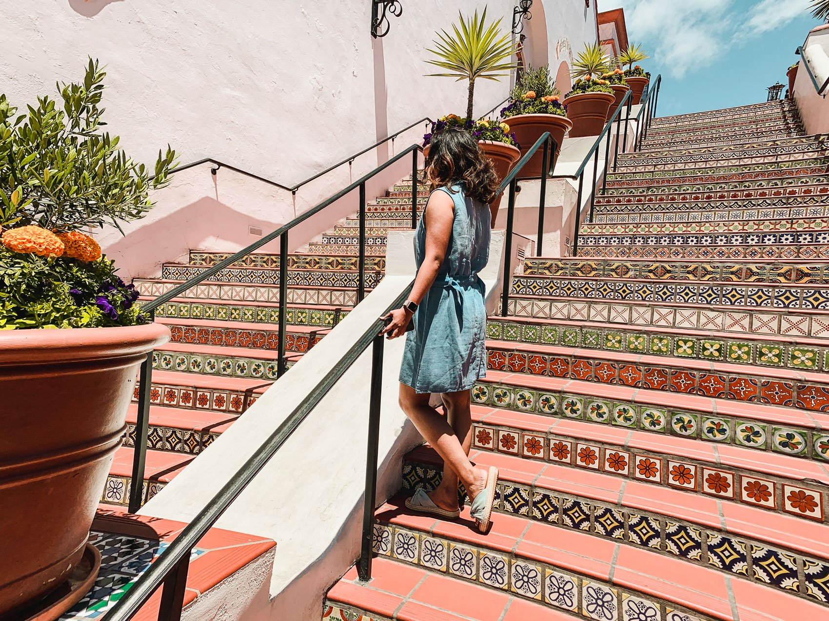 Woman standing on stairs at Paseo Nuevo Mall Santa Barbara
