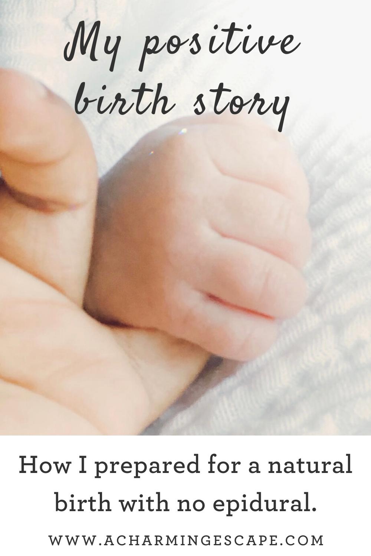 baby holding mom's finger